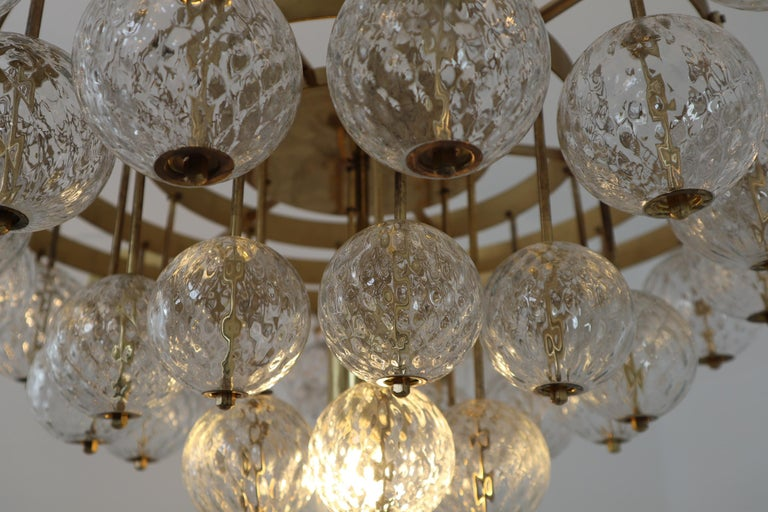 Large Mid-Century Chandelier with Brass Fixture and Structured Glass Globes For Sale 5