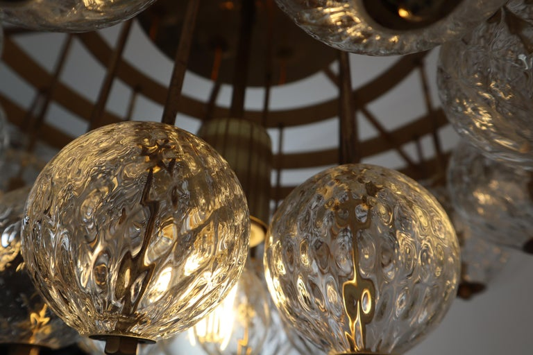 20th Century Large Mid-Century Chandelier with Brass Fixture and Structured Glass Globes For Sale