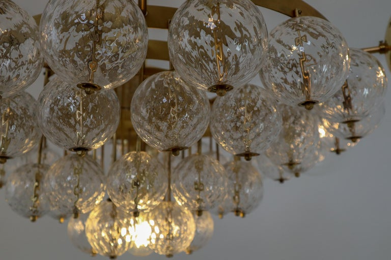 Large Mid-Century Chandelier with Brass Fixture and Structured Glass Globes For Sale 1