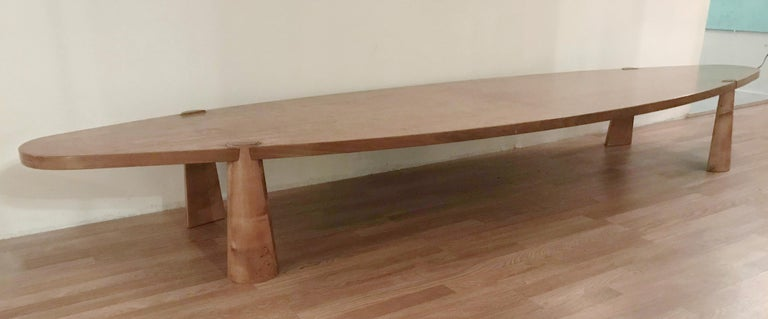 Vintage wooden table originally made for a hotel lobby in Northern Italy, made in the 1960s. This table has a large oval shaped top and four-cone shaped legs, in the style of Angelo Mangiarotti. Measures: length 134 inches, width 36 inches, height