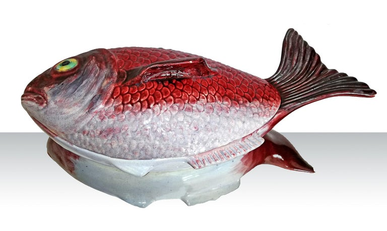A magnificent big size hyper realistic glazed ceramic fish tureen in shades of vibrant red and grey with dark accents manufactured in Portugal, 1950s. Beautiful to use as a wall decoration or as serving tureen. A beautiful example of the traditional