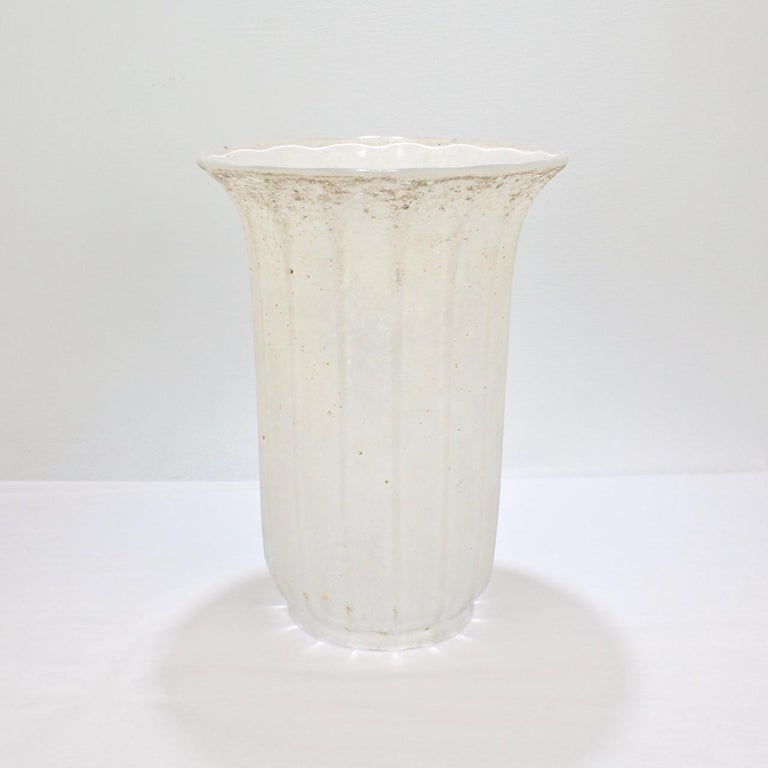 A large, Italian white art-glass vase in the 'scavo' technique.   Attributed to Archimede Seguso and Seguso Vetri d'Arte.  The white textured finish of the vase offers a perfect compliment to warm-toned woods and surfaces painted with saturated