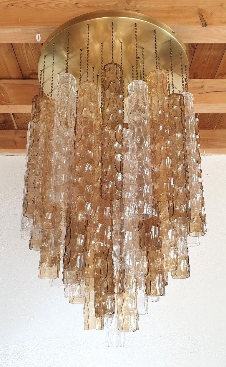 Large Mid-Century Modern Murano glass flush mount chandelier, by Mazzega, Italy, 1970s. Made of alternating 3 colors of bamboo shaped Murano glasses: transparent, beige and brown. Around 60 tubes of glass in excellent condition, for this 5 tiers