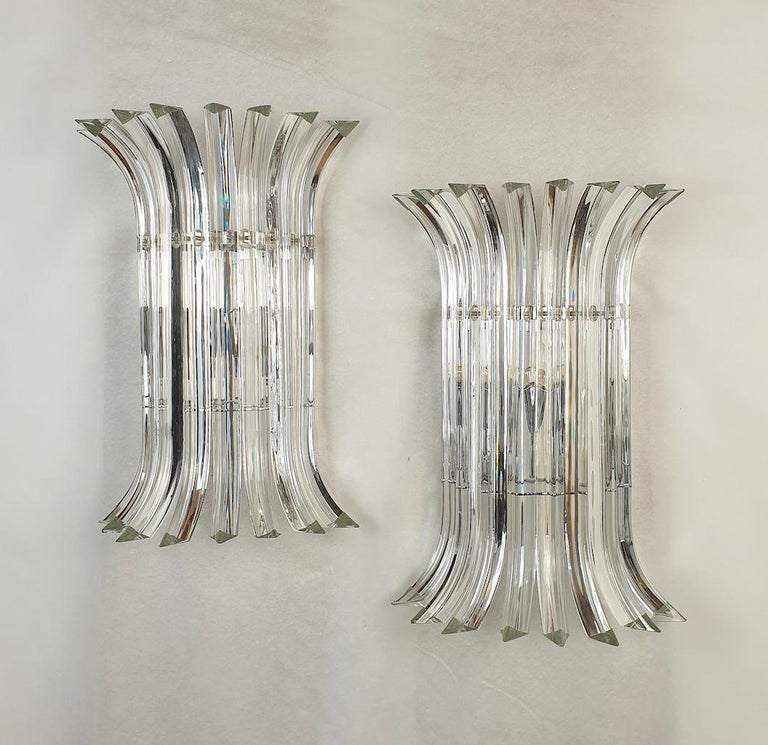 Pair of large geometrical Mid-Century Modern Murano glass sconces, by Venini Italy 1980s. Two pairs available. Sold and priced by pair. A modern design for these Triedri clear Murano glass with chrome mounts sconces. The vintage sconces have 2