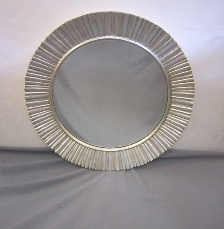Elegant vintage Mid-Century Modern hand carved, original silver leaf fluted star burst mirror. 