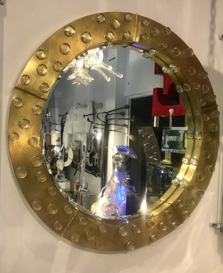 Spectacular large round Italian brass framed mirror adorned with hand blown Murano glass.