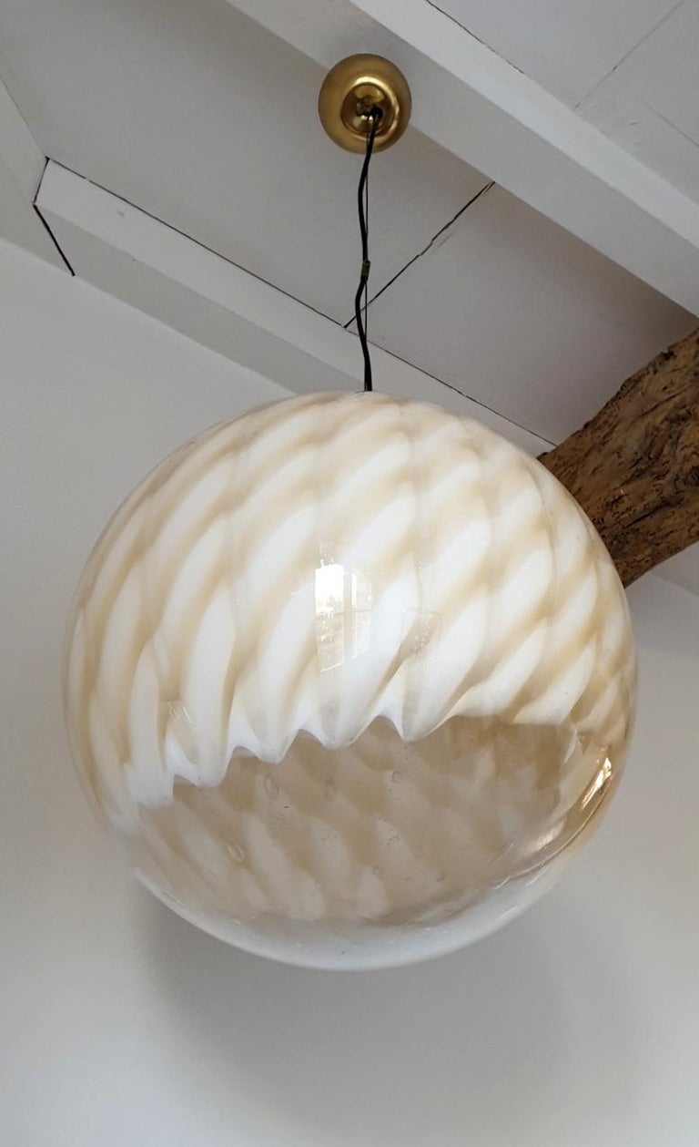 Large Mid-Century Modern stamped Murano glass globe ceiling pendant light, by Toni Zuccheri for Venini.