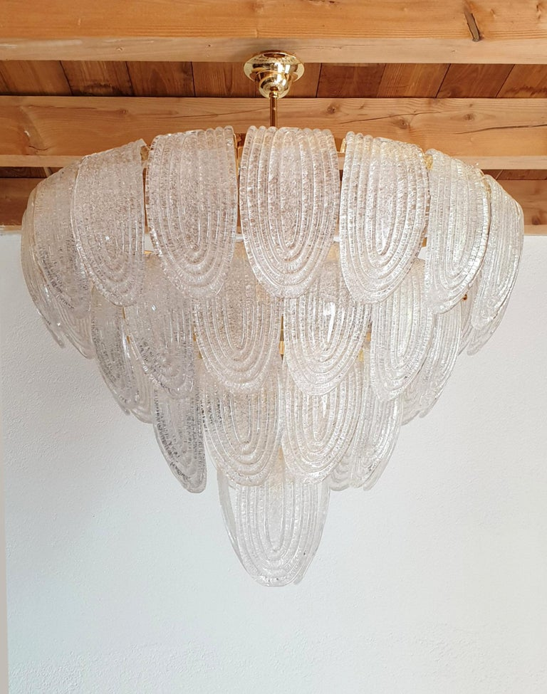 Large Mid-Century Modern translucent and textured Murano glass chandelier, with gold plated frame & chain. Can be hanged as flush mount fixture, or as a chandelier, with a central stem and canopy H 13 in. Height glass chandelier only: 23.23