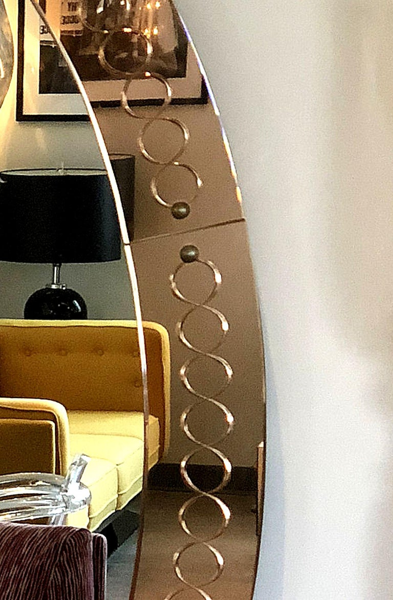 Vintage large oval shape wall mirror, by Cristal Arte, Italy, 1960s.  The Mid-Century Modern Italian mirror has a bronze color, etched & beveled glass mirrored frame.   Very stylish and chic Italian mirror. In very good condition: minor signs of