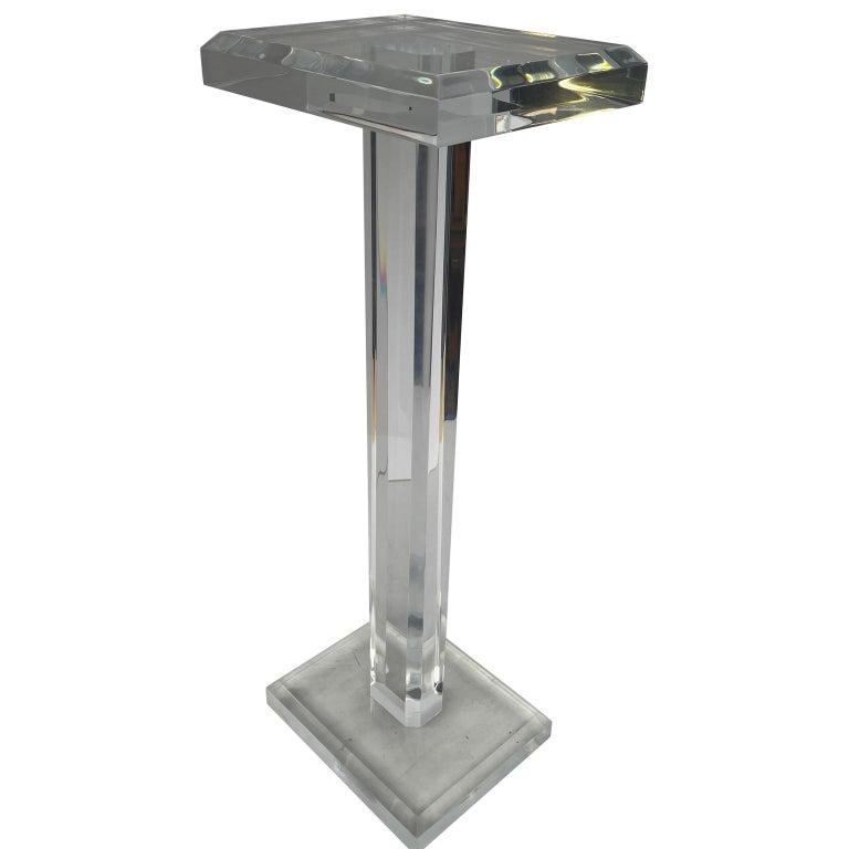 American rectangular Mid-Century Modern thick Lucite pedestal.