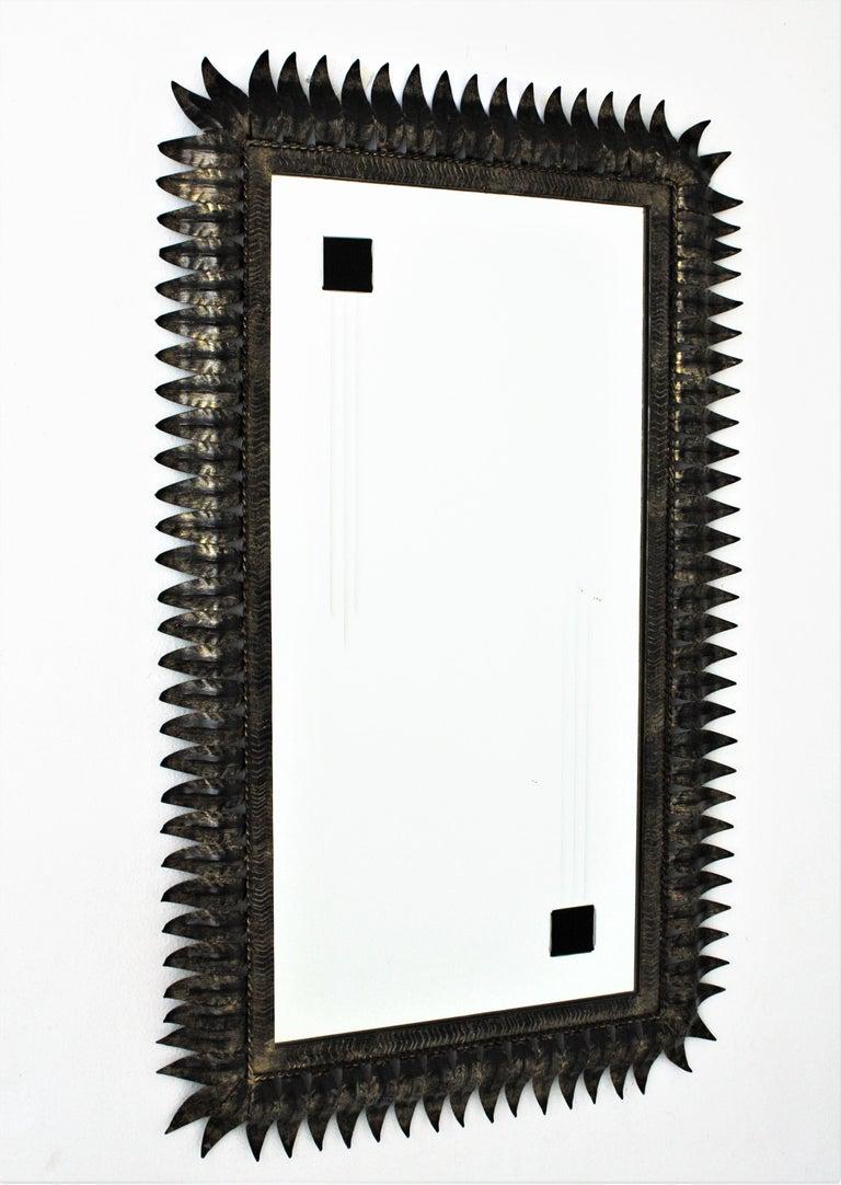 Hammered Large Mid-Century Modern Spanish Parcel Gilt Iron Rectangular Sunburst Mirror For Sale