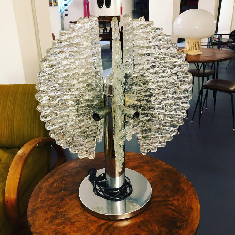 Great vintage condition for this table lamp made from thick Murano glass and chrome. Designed by Carlo Nason for Mazzega.