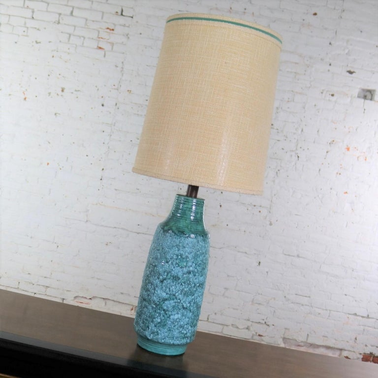 Handsome very large Mid-Century Modern ceramic table lamp with a gorgeous turquoise lava glaze and its original shade done in the style of the famed Fantoni. This great lamp is in wonderful vintage condition as is the large drum shade. Please see