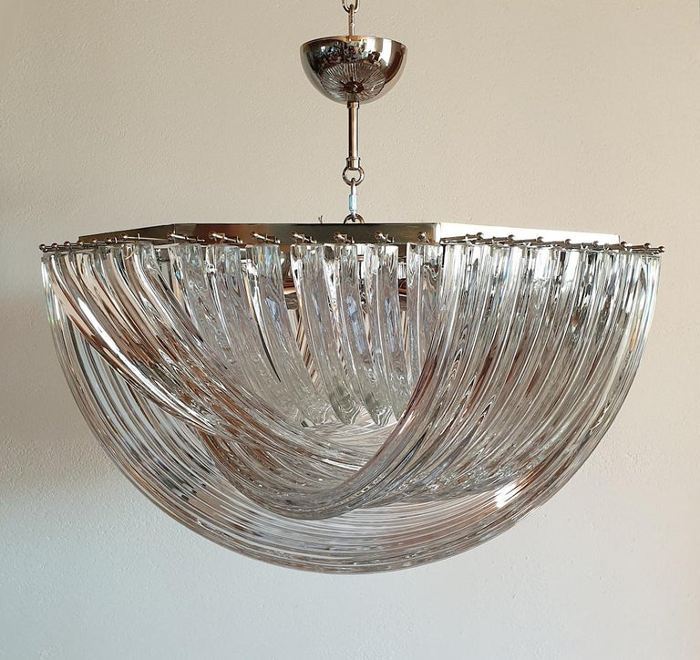 Large Mid-Century Modern octogonal Venini chandelier or flush-mount, with clear Murano glass and a chrome frame, Italy, circa 1980s. The vintage chandelier is made of four layers of curved handmade Triedri clear Murano glass, excellent