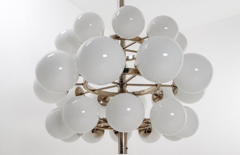 Mid-Century Modernist extreme large chandelier with 30 hand blown opaline glass globes. The fixture is made of metal with a chrome-brass patina. Therefore an interesting color is visible on the metal. Thirty opaline glass globes are placed over