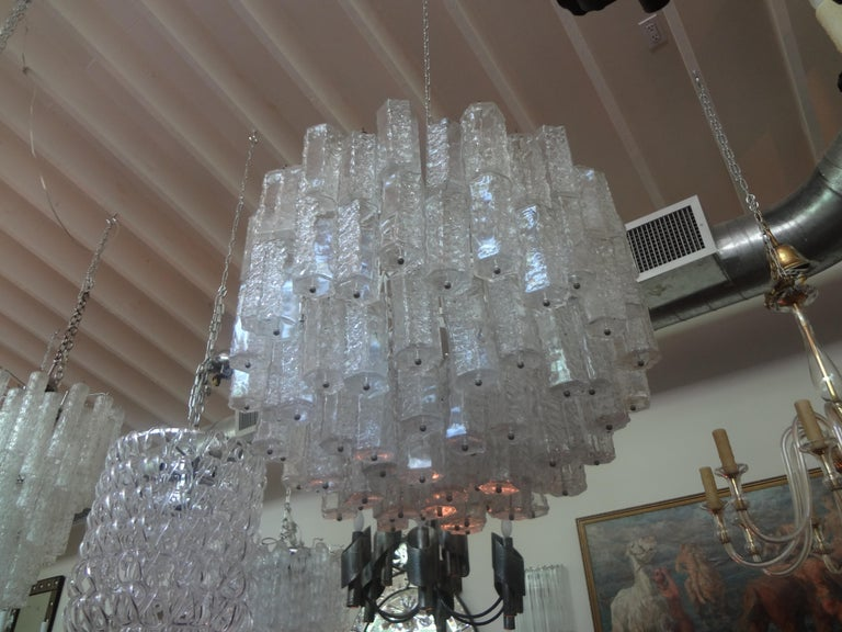 Stunning large mid-century clear Murano glass chandelier by Toni Zuccheri for Venini. This beautiful Murano glass chandelier is comprised of unusually shaped glass on a steel frame. The glass portion of our Murano chandelier measures 22 inches H and
