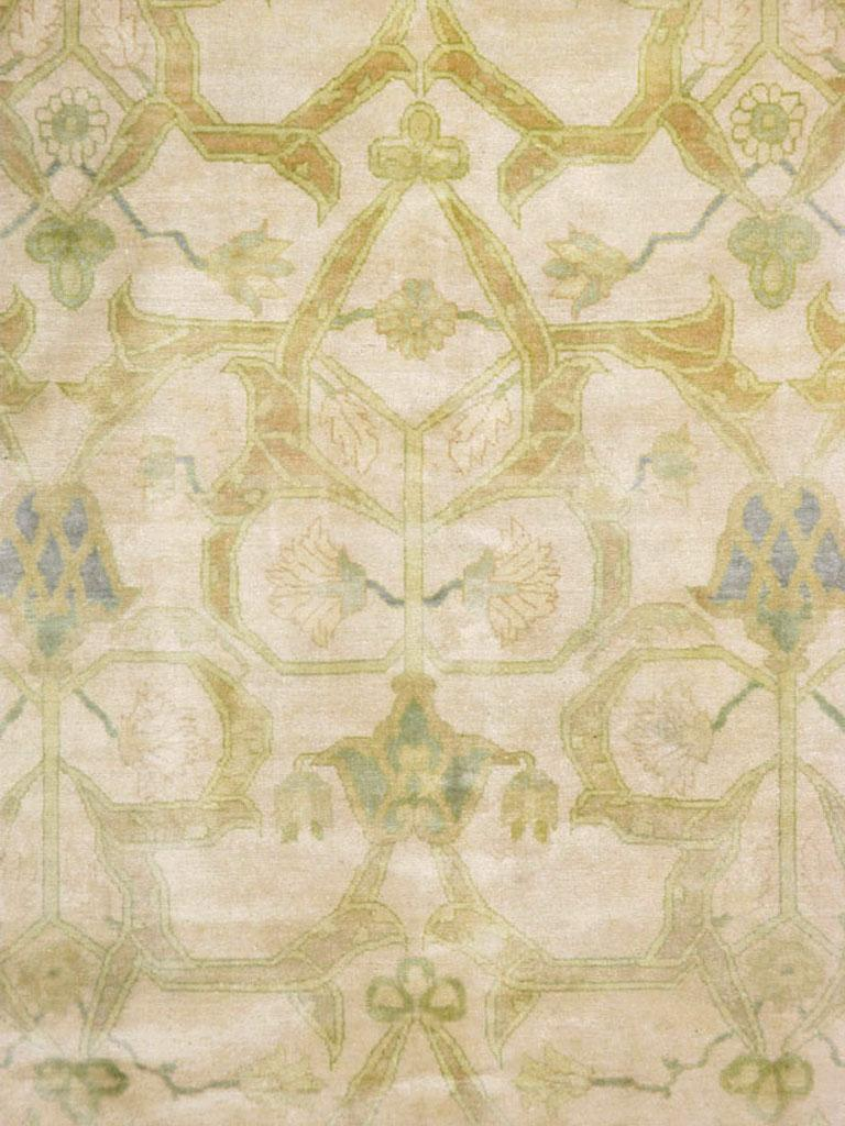A vintage Persian Tabriz Modernist carpet from the mid-20th century. The ivory field displays an allover pattern of thick arabesques forming pointed or otherwise shaped open sections, with small palmettes and flowers accentuating the whole. A