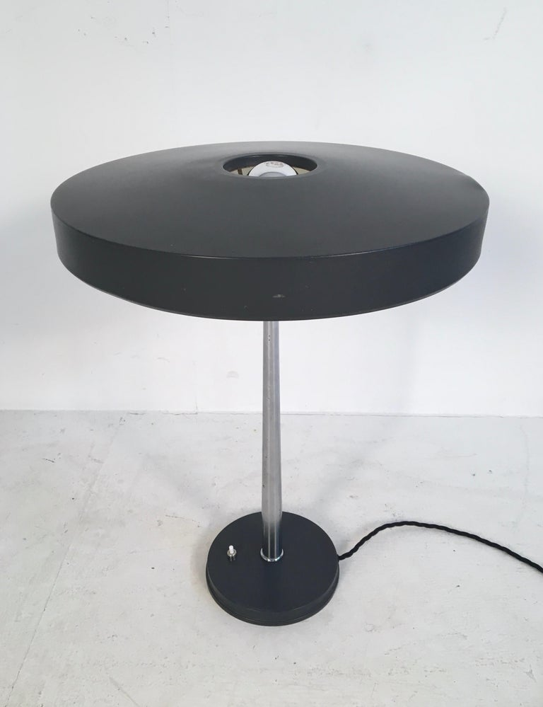 Large iconic metal desk lamp designed by Louis Kalff for Philips in the 1950s.  In full working order.