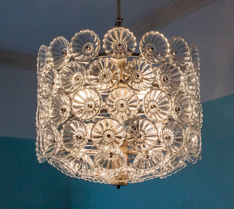 Great grand chandelier in cylindrical shape with 80 glass flowers with no chips or cracks. Build in the former GDR, Oest Germany in the 1960s-1970s by Neuco Ebersbach. Very interesting for collectors as its a closed collectors area.  Rises its