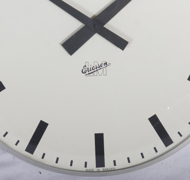 LM Ericsson. Electric metal wall clock, vaulted dial glass, rebuild to battery movement. Sweden, 1960s. Measure: Ø 41 cm. Very good original condition Delivery time 2-3 weeks.