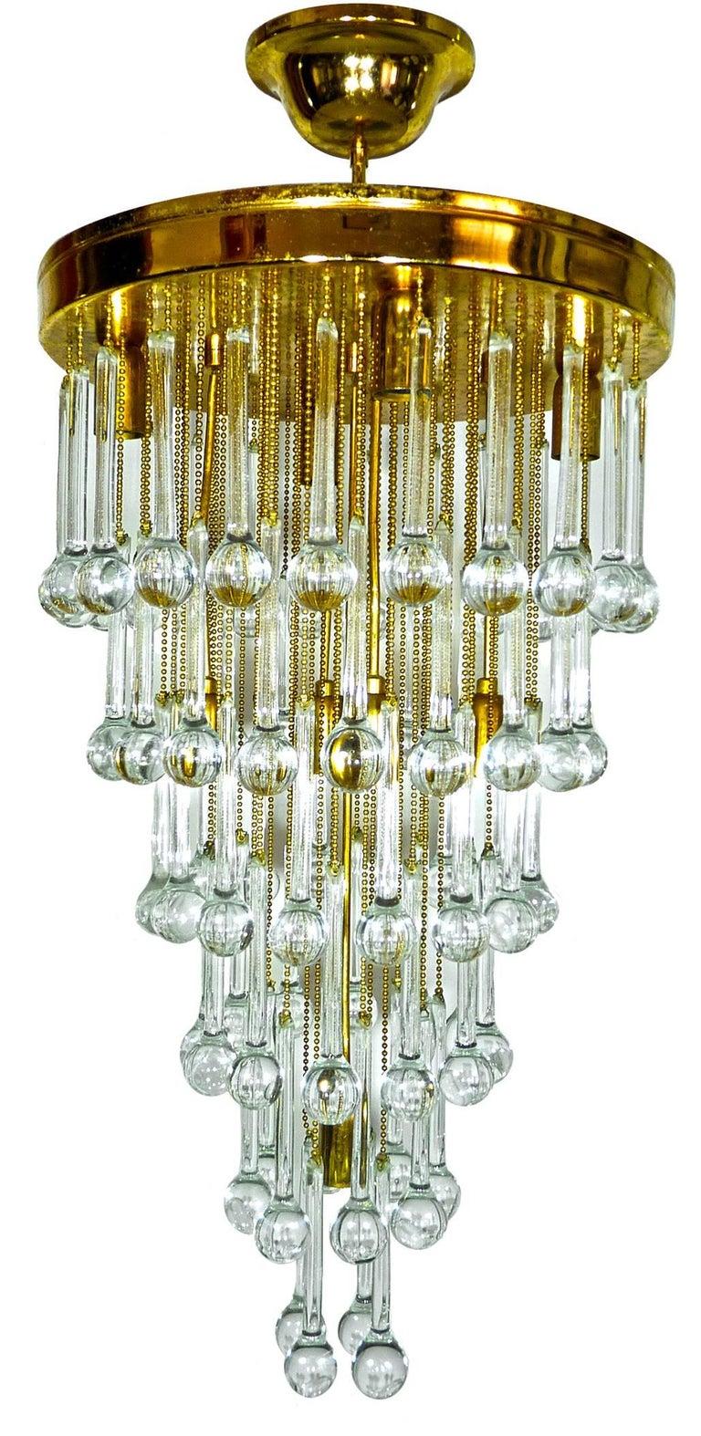 German Large Midcentury Hollywood Regency Crystal Waterfall Weddingcake Gilt Chandelier For Sale