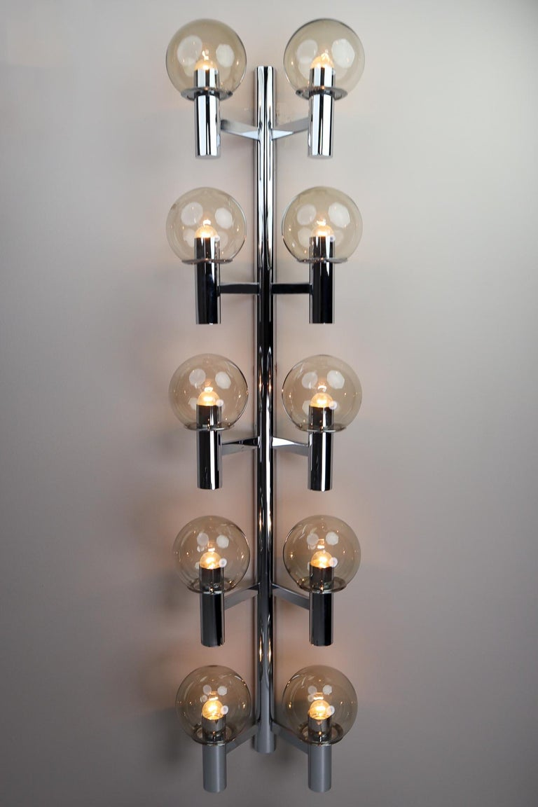 Large midcentury modern chrome wall lights- sculptures produced in Italy 1970s. The pleasant light it spreads is very atmospheric, these wall scones or fixtures will contribute to a luxurious character of the (hotel-bar) interior. Perfect original