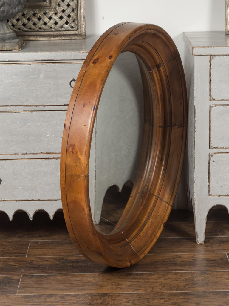 Large Midcentury Pine Bullseye Mirror with Brown Patina and Molded Accents For Sale 1