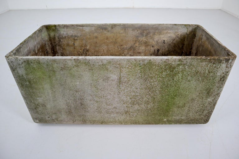 Large midcentury concrete planter by Swiss architect Willy Guhl for Eternit. Excellent patina and coloring. Great sculptural planter or garden objects. Perfect for indoors or outside.