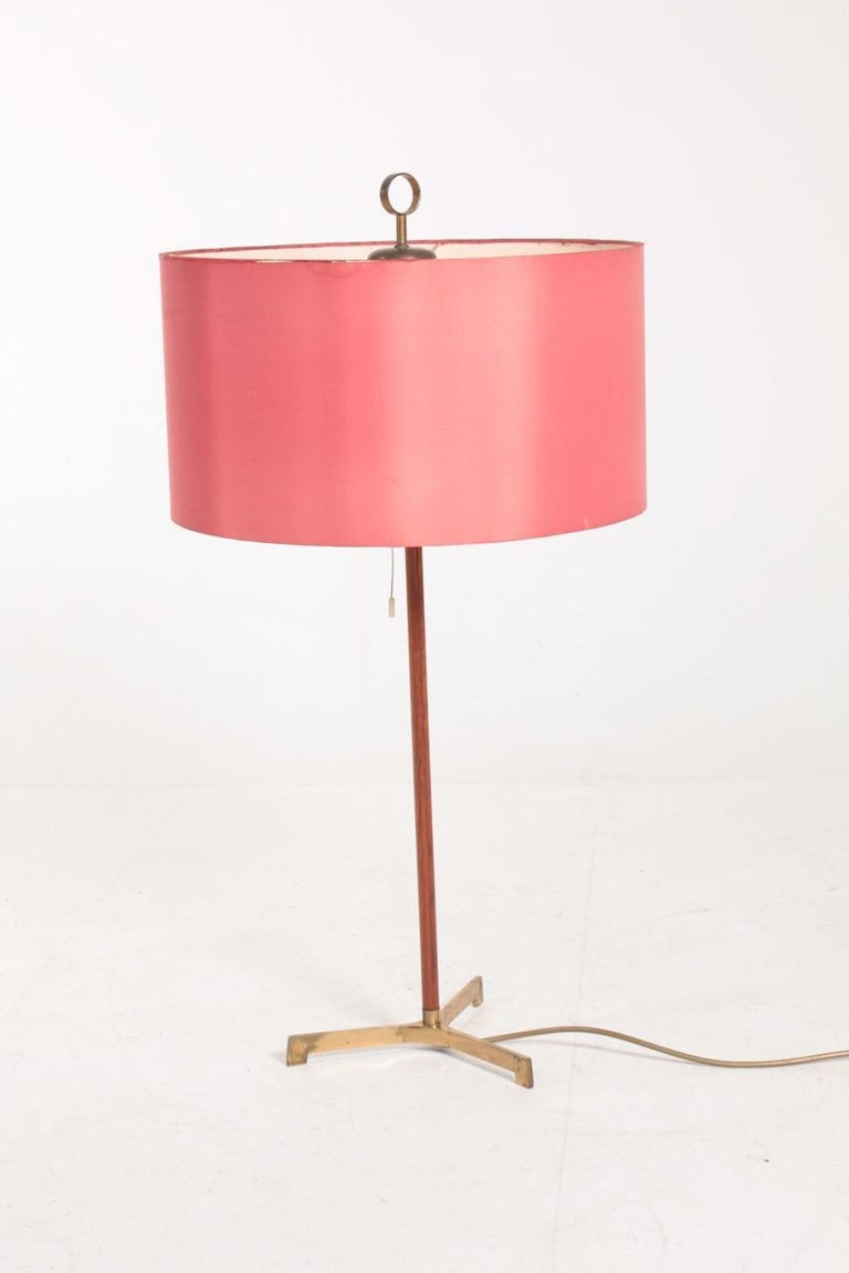 Large table lamp in teak and original shade designed and made in Denmark. Original condition.