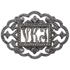 Large Miriam Haskell Oval Silver Tone Cut Steel and Marcasite Initial Brooch