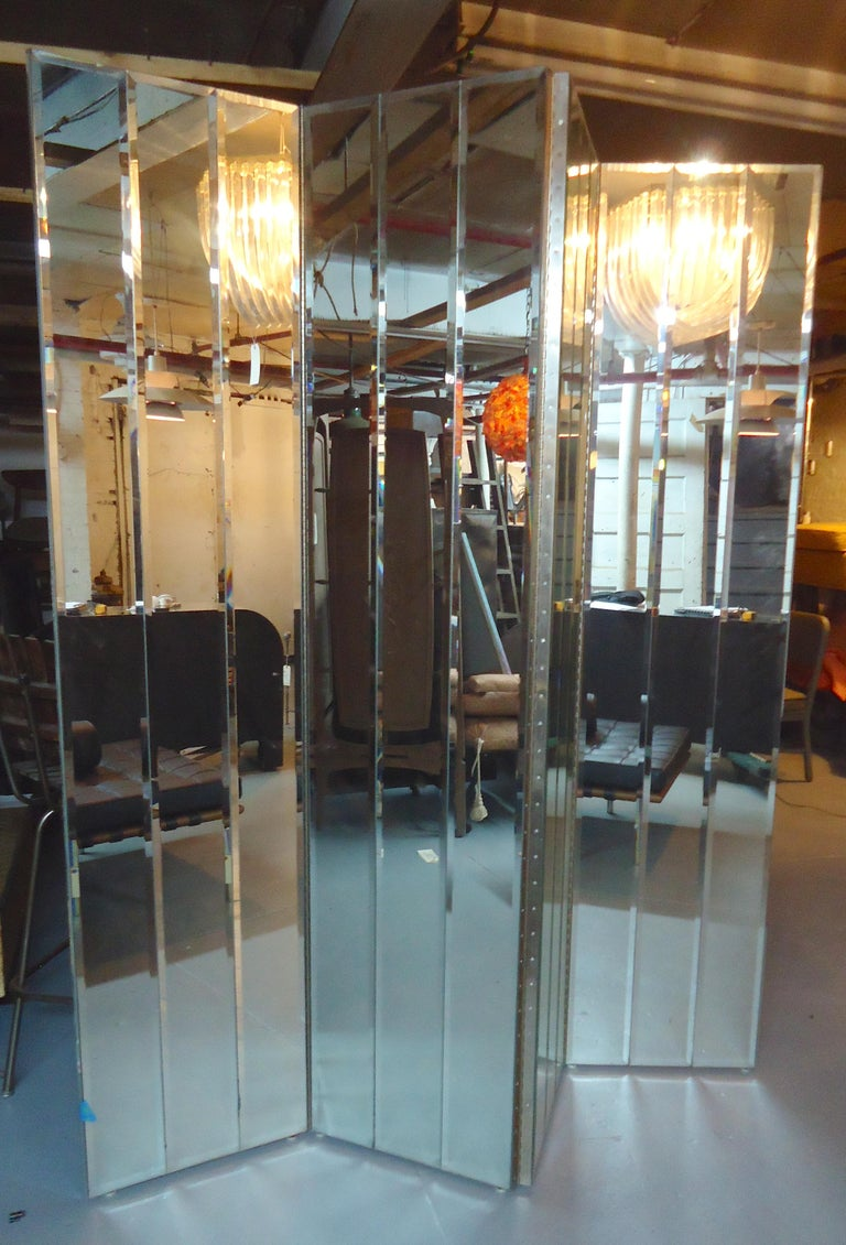 Vintage four panel mirrored room divider with beveled glass. Very heavy and sturdy.  (Please confirm item location - NY or NJ - with dealer).
