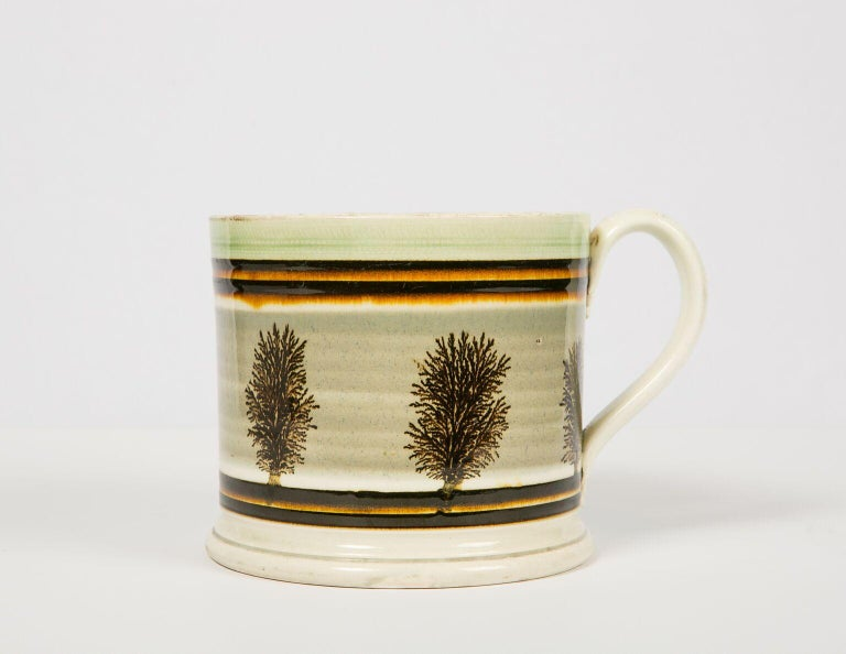 WHY WE LOVE IT: A perfect combination of form and decoration We are delighted to offer this mochaware quart mug. Made in England, circa 1825 it is a masterpiece of mochaware. It has a strong presence and is beautiful. The decoration all works