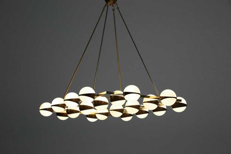 Beautiful modern chandelier Stilnovo style, structure in brass with opaline light. 20 big globes. Measures: Diameter opaline 14 cm. Bulb E14.