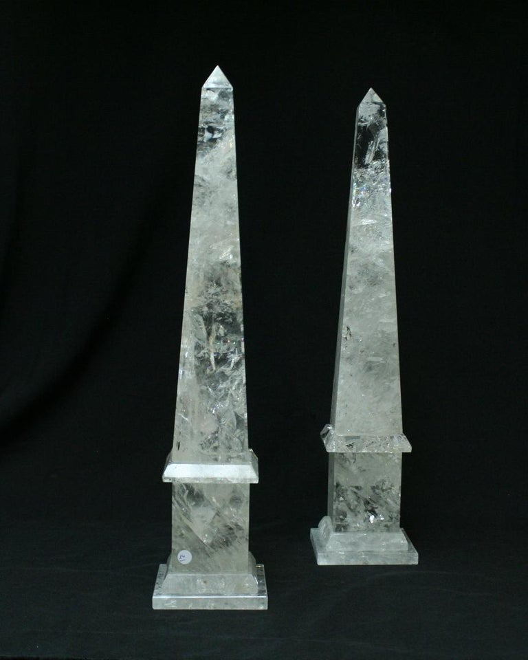 Large modern hand carved and hand polished rock crystal obelisks. Simple traditional form with a long taper point, bevelled edge and square plinth base.   Various other sizes are also available upon request.   (N).