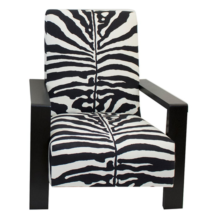 Large modern lounge chair built in dark espresso stained solid mahogany frame and covered with a zebra linen fabric by Scalamandre. The reflective sheen on arms and legs give it an elegant finish. The deep, firm seat cushion is made with 8-way hand
