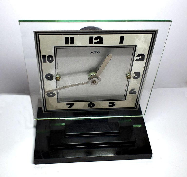 One of the more rare Art Deco clocks is this wonderfully stylish and totally authentic 1930s Art Deco clock by ATO the French clock makers. This clock has a mixtures of materials, mainly bakelite and clear and silvered glass. Very iconic looking