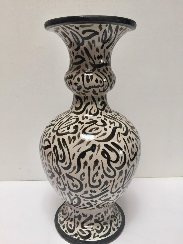 Large Moroccan glazed ceramic vase from Fez. Moorish style ceramic handcrafted and hand painted with Arabic calligraphy writing. This kind of art writing looks calligraphic is called Lettrism, it is a form of art that uses letters that are not