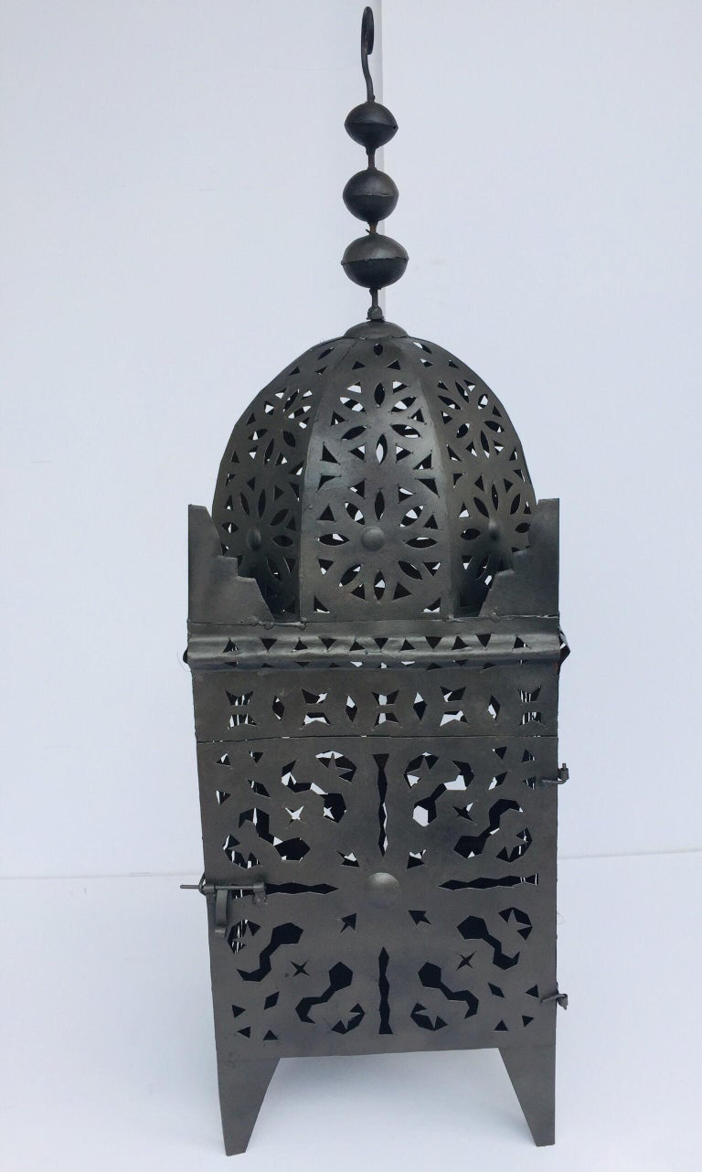 Moroccan Moorish metal candle lantern. Hurricane candle lamp handcrafted in Morocco by artisans, metal handcut and hammered with Moorish designs, open in front for use with pillar candles. The candle lanterns are great to use indoor or