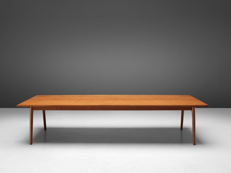Conference table or dining table, oak, Denmark, 1950s.  Large conference- or dining table in oak. The rectangular shaped tabletop is made out of one piece, featuring a beautiful grain. The base consists of four conical legs and shows beautiful