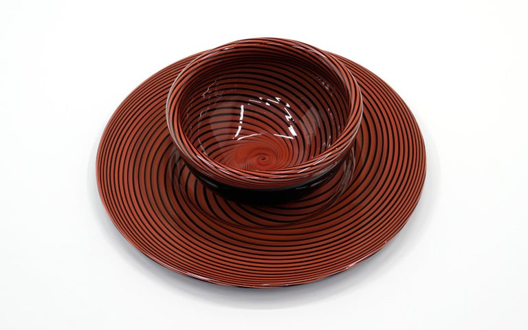 Red and Black swirl Murano hand blown art glass bowl and charger. Mint Condition Plate 21.75 inches diameter, 1.5 inches height. Bowl 12.5 inches diameter, 6 inches height.