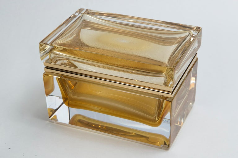 One of a kind Murano handcrafted large rectangular shaped clear blown glass box with floating 24-karat gold orb center, customized sizing for each box with 14-karat gold on brass fittings.
