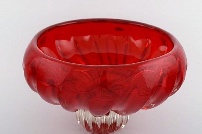 Large Murano bowl on foot in red and clear mouth blown art glass. Italian design, 1960s.
