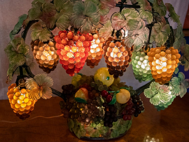 Very rare eight-light Venetian glass grape and fruit basket leaf table lamp, with clustered grapes as shades, hand blown applied leaves in the style of Art Nouveau. Blown green glass base with different colored clusters of grapes shades with iron