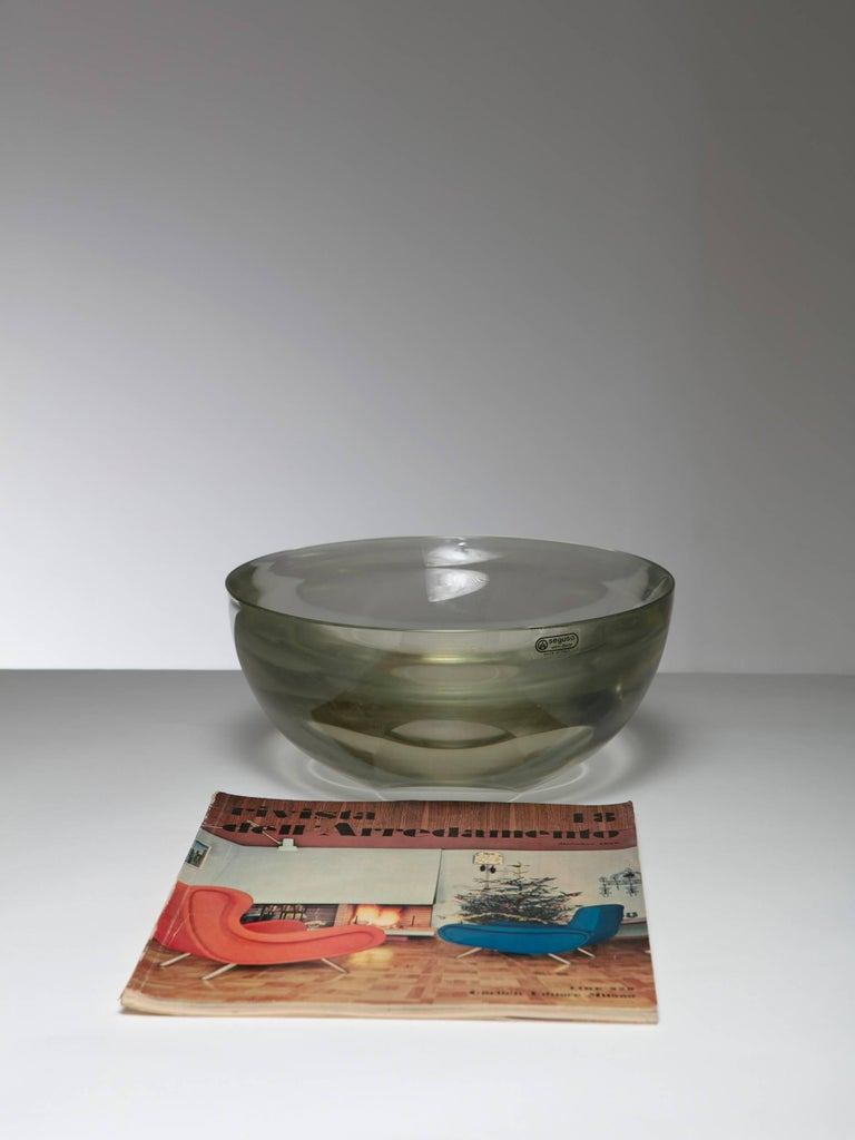Large Murano glass bowl by Seguso. Solid glass translucent lens.