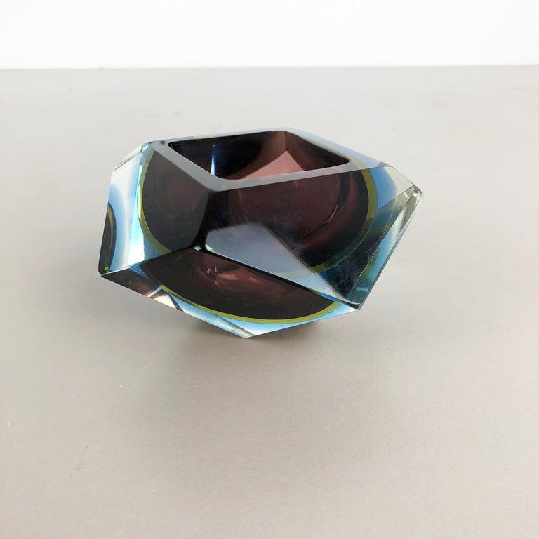 Article:  Murano glass ash tray   Origin:  Murano, Italy   Design:  Flavio Poli   Decade:  1970s    This original vintage glass ash tray bowl element was designed by Flavio Poli and produced in the 1970s in Murano, Italy. It is made in Sommerso