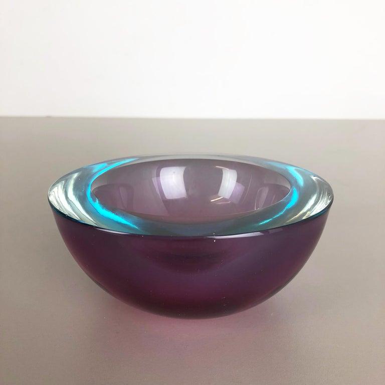 Article:  Murano glass bowl element   Origin:  Murano, Italy   Design:  Flavio Poli attributed.   Decade:  1970s    This original vintage glass ash tray bowl element is attributed to Flavio Poli and was produced in the 1970s in