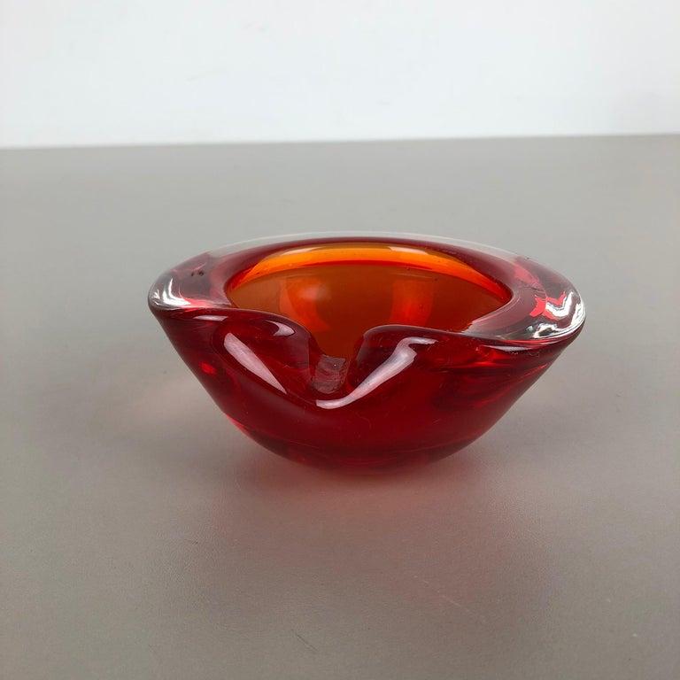 Article:  Murano glass bowl, ashtray element   Origin:  Murano, Italy   Decade:  1970s    This original vintage glass bowl element, ash tray was produced in the 1970s in Murano, Italy. It is made in Murano technique and has a