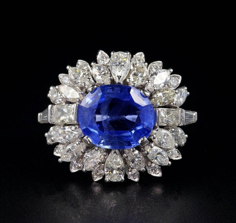 An impressive Diamond and sapphire cocktail ring. Large crown beautifully designed and hand crafted during the 60's. Platinum skilfully hand made. Italian origin. Boasting a magnificent 7.46 Ct Natural no heat Sapphire Ceylon origin - fully