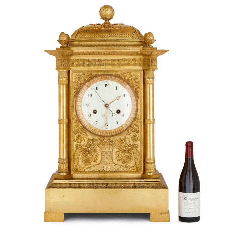 French Large Neoclassical Style Gilt Bronze Mantel Clock by Piolaine For Sale
