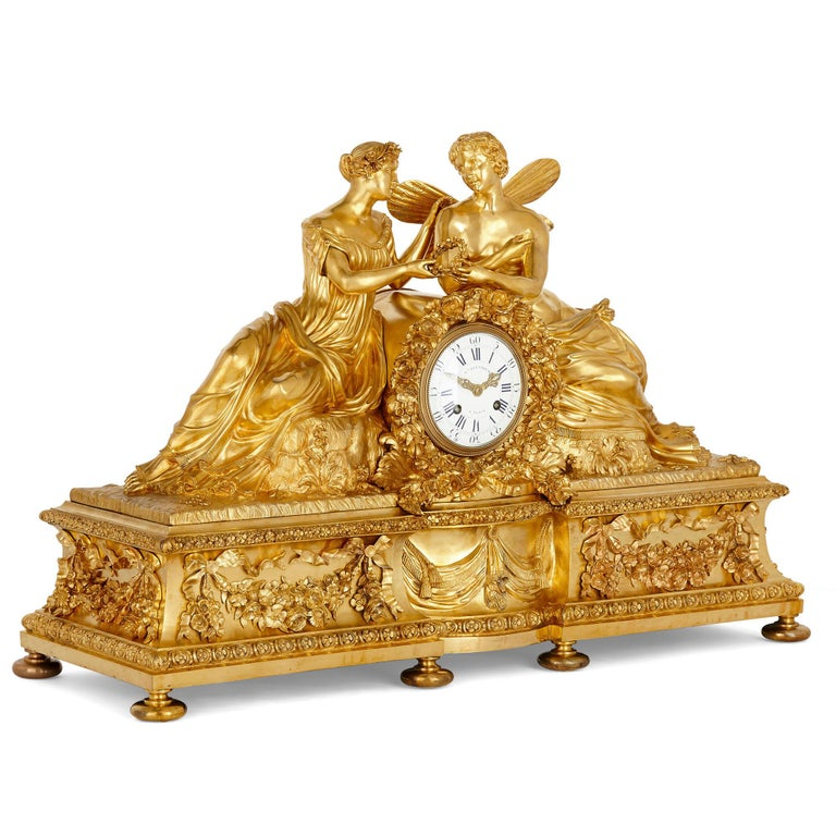 Large neoclassical style gilt bronze mantel clock with cupid and psyche French, 19th century Measures: Height 54cm, width 80cm, depth 30cm  This beautiful mantel clock features a case wrought entirely from gilt bronze in the ornate Louis XVI